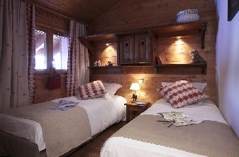 A typical twin bedroom for one bedroom Meribel apartments
