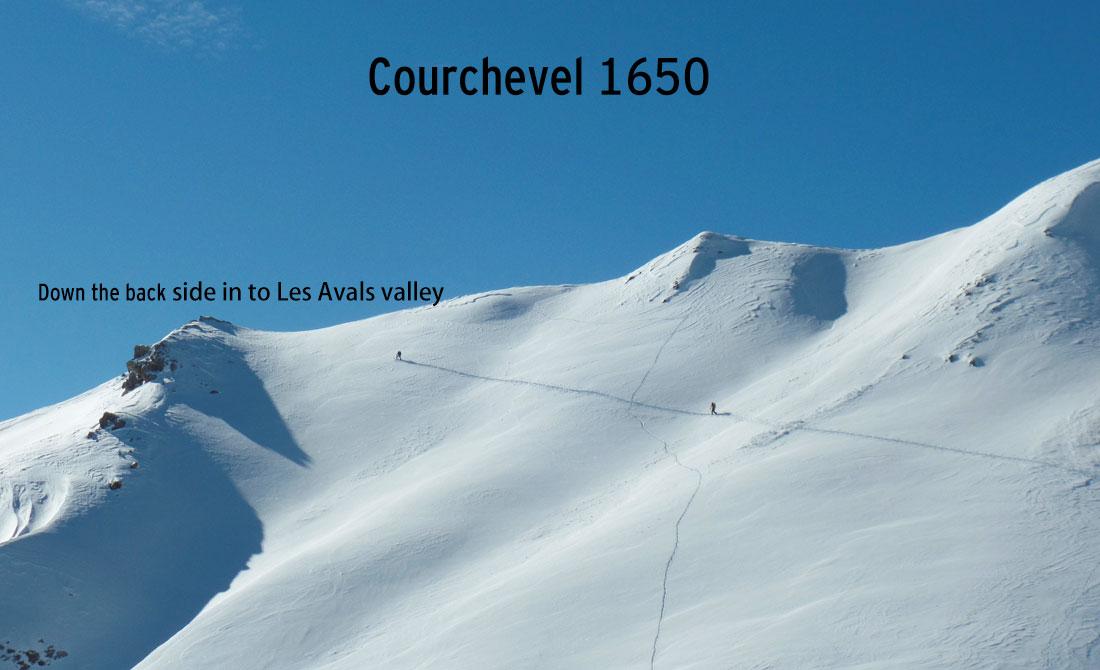 Meribel skiing early morning piste. Sun and great snow.
