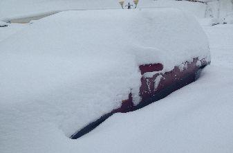 Car buried in snow again.